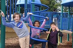 3 Students on Blue Jungle Gym